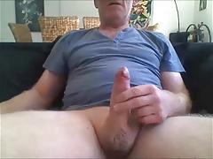 Mature uncut guy unloading his cock
