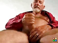 Daddy bear playing with his cock