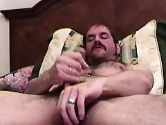 Hairy aunt with pierced balls jerks off