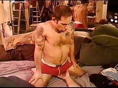 CBT squeezing hairy chested muscled dude\'s balls through