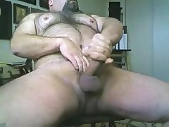 Hairy bear stroking his cock