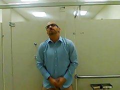 Jerking in a public restroom
