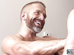 Two young hunks drill one mature daddy