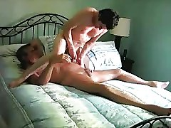 Two mature older men play with each other