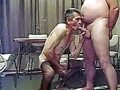 Older man sucking another man