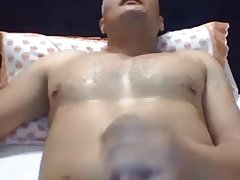 Hunk daddy wanking on bed