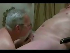 Three mature men sucking each other