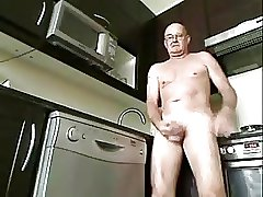 A uncle masturbating in the kitchen