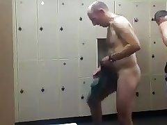 Bald daddy stripping at gym