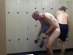 Bald daddy stripping at gym