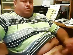 Chunky daddy stroking at office