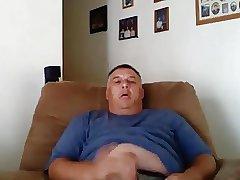 Hot daddy wanking on cauch