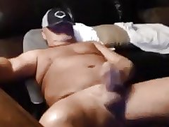 Beefy daddy playing with cock