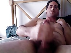 Handsome hairy dude wanking