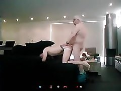 Old man fucking younger guy on sofa