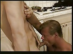Mature and Boy in the Kitchen