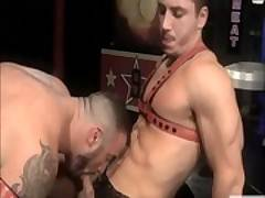Gay in leather wanks his cock on an ass