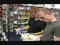 Blu and Trae wanna be very bad. Come and see the gorgeous redhead and his hunky blonde friend sucking their cocks while choosing a movie at the video store.