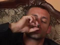 Bald man sucking cock of smoking stud