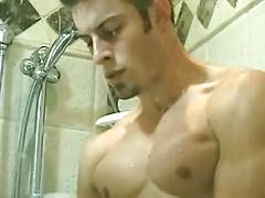Sexy Jock blows a load on shower door