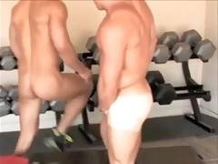 Naked gym buddies help each other out