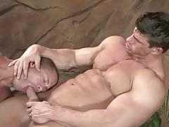 Bodybuilders enjoy a hot tub