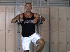 Hot muscle dude polishes his dumbbell