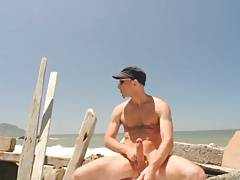 French dude exhibits on sea shore