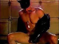 Young Cigar Smoking Leather Hunk