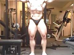 Str8 bodybuilder posing in the gym