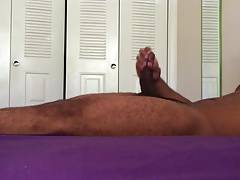 Relaxing in bed jerking my big cock