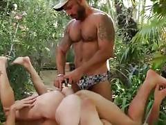 Helper pleasing two asses with a double dildo