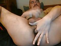 Bear jerking off and fingering ass