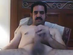 Very handsome macho jerking off playing with nipples