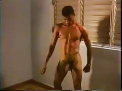 Latino hunk jerks off stripping and dancing