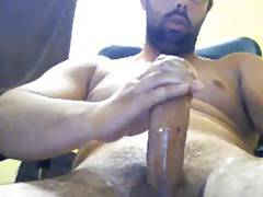Stoky bearded guy wanking his monster cock