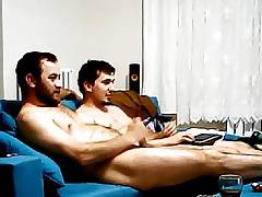 Sexy couple having fun on sofa