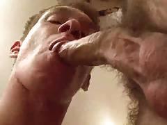 Guy bouncing between two cocks.