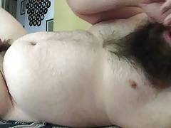 Beardy guy cums on his own face