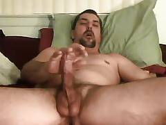 Hunk dude stroking hard on bed