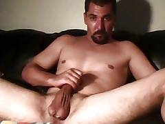Hunk dude stroking hard on cauch