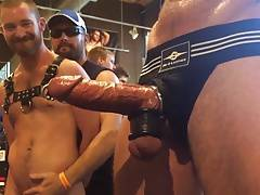 Guy watches big cock whilst being wanked...