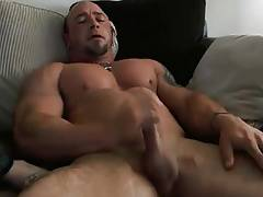 Hot muscular dude wanking and cumming on chest