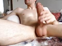 Tugging massive shaved cock and big balls