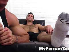 Cute hunk couple Ricky and Cole sharing feet fetish passion