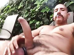He jerks his hard uncut dick outside