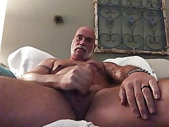 Dad tugging on his pig nips stroking the daddy dick