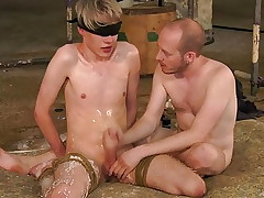 Tied up slim twink gets dick sucked and jerked off by master