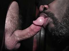 Black sucks off hard white dick