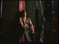 Hunks in leather and metal chains
